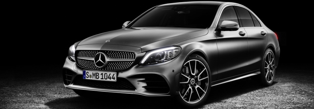 Silver 2019 Mercedes-Benz C-Class on a black background