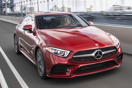 Red 2019 Mercedes-Benz CLS driving along bridge