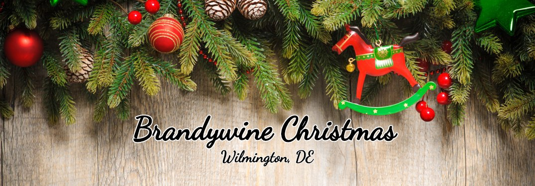 Brandywine Christmas Wilmington, DE text under Christmas wreath