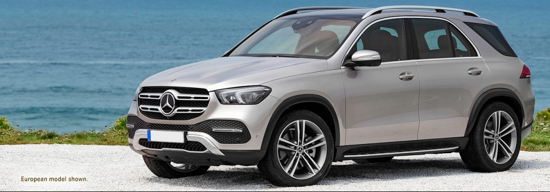 A 2020 Mercedes-Benz GLE sits on the shore with blue water behind it.