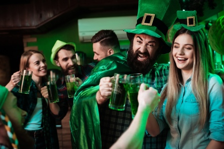 Group of friends drinking green beer on St. Patrick's Day
