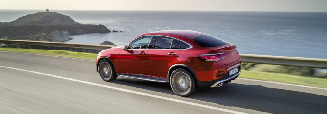 Red 2020 Mercedes-Benz GLC Coupe driving along coast