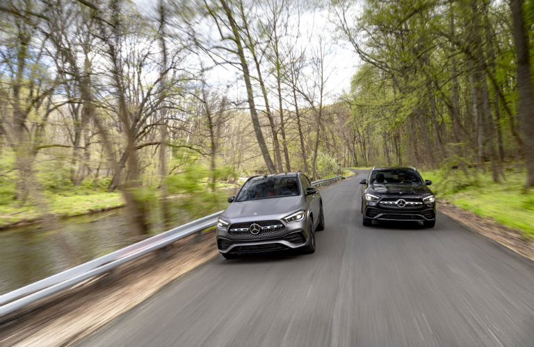 Two 2021 Mercedes-Benz GLA SUVs driving on a road
