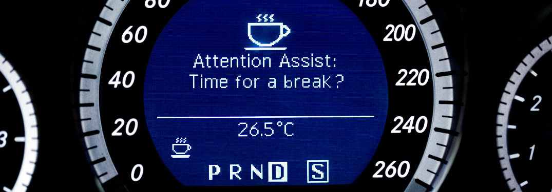 close up of speed gauge of mercedes-benz vehicle with attention assist warning