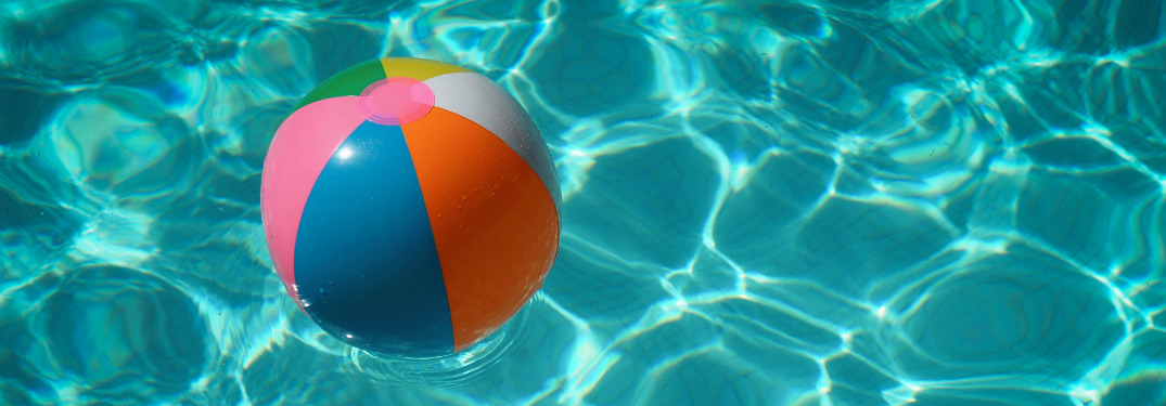beach ball floating on water in swimming pool