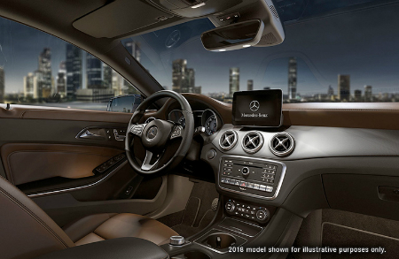 front interior of 2019 mercedes-benz cla 250 including steering wheel and infotainment system