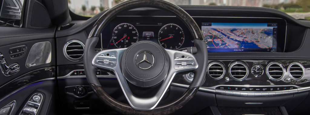 front interior of 2019 mercedes-benz s-class sedan including steering wheel and infotainment system