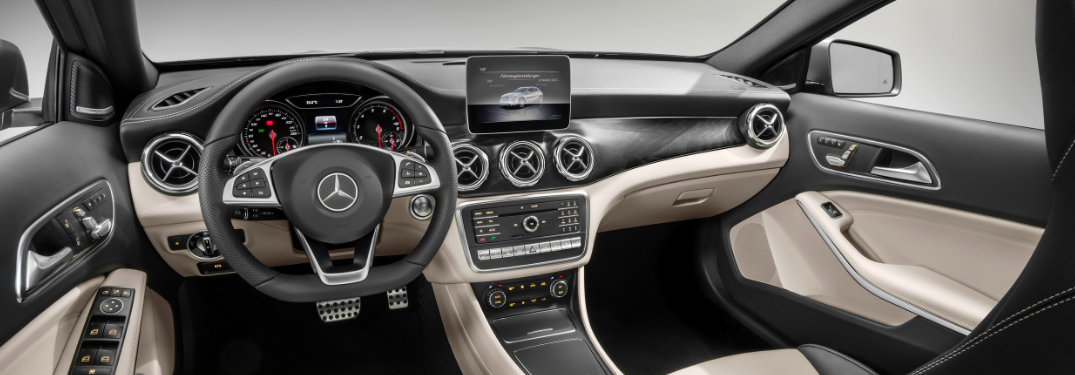 front interior of 2019 mercedes-benz gla 250 suv including steering wheel and infotainment system