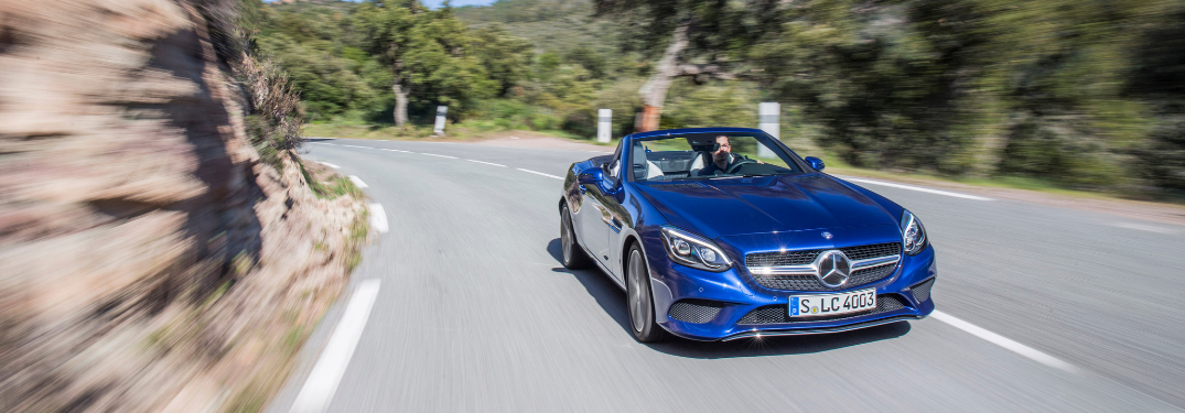 front and side view of blue 2019 mercedes-benz slc 300 roadster