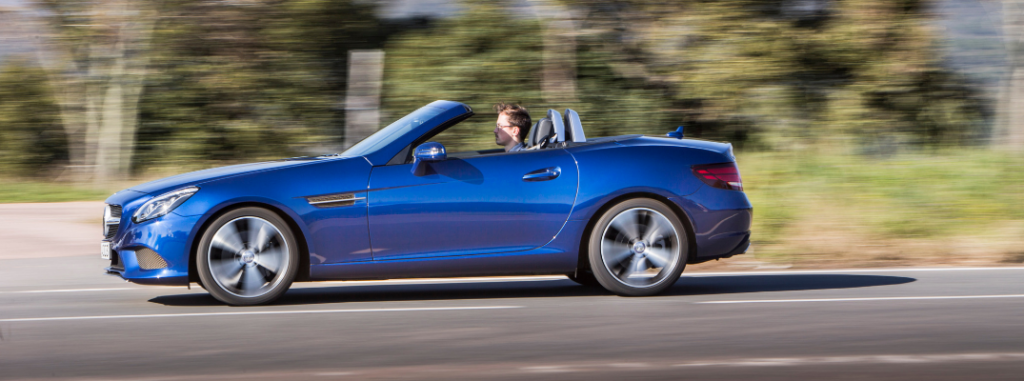 side view of blue 2019 mercedes-benz slc 300 roadster