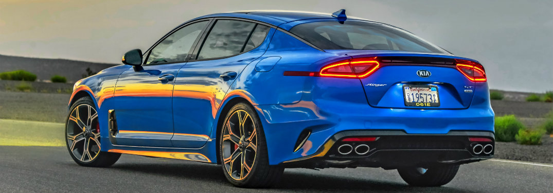 rear and side view of a blue 2018 Kia Stinger GT2 with all-wheel drive