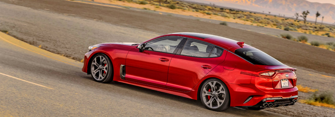 side view of a red 2018 Kia Stinger on the track