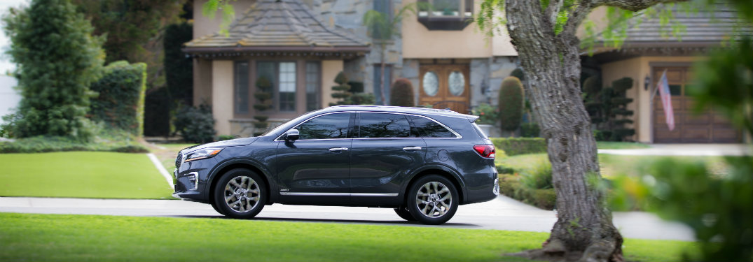 side view of the 2019 Kia Sorento driving in a rural area