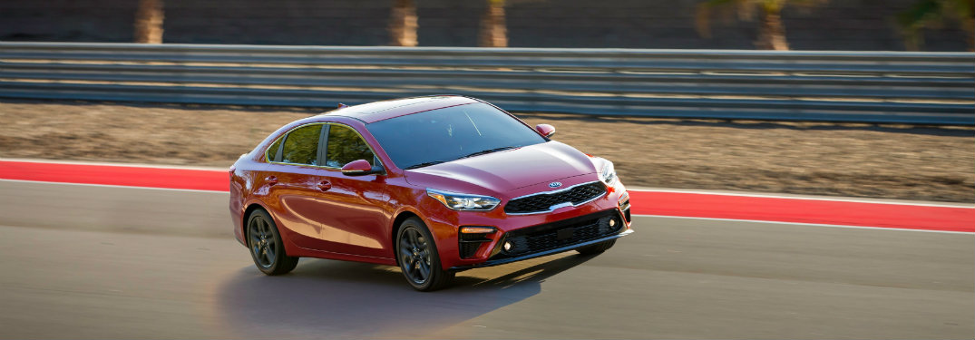 red 2019 Kia Forte driving on a track