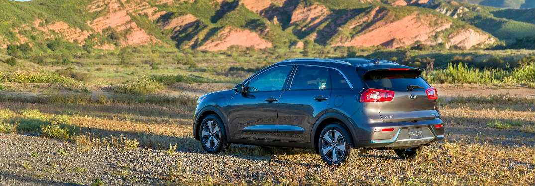 ... Rear View Of The 2018 Kia Niro Parked In A Semi Desert Environment