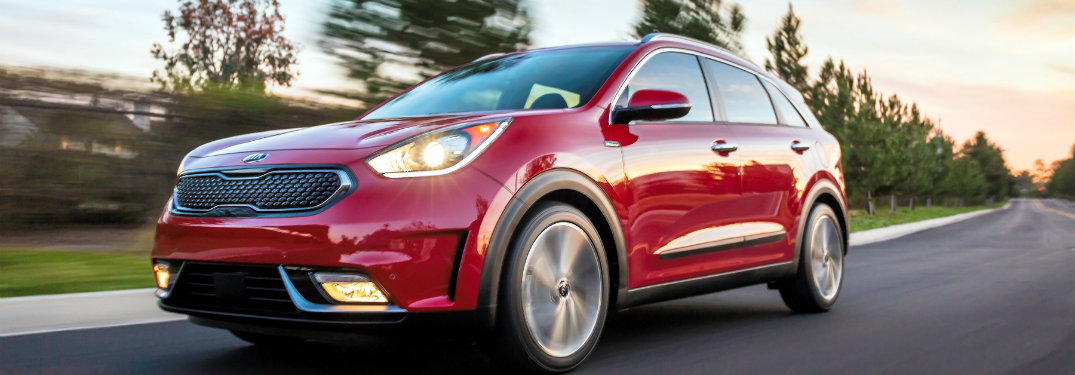 side view of a red 2018 Kia Niro