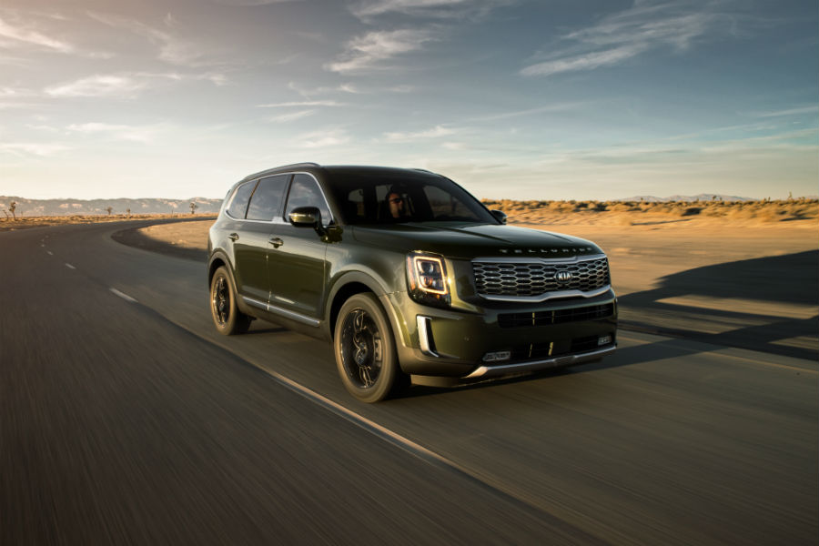 A front right quarter photo of the 2020 Kia Telluride in motion on a desert road.