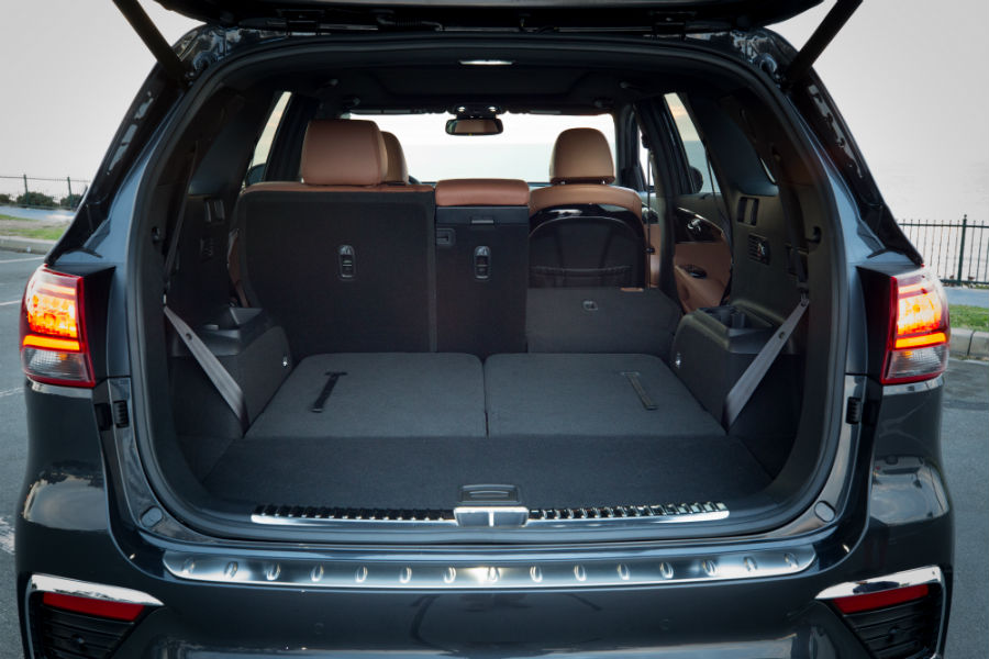 A photo of the cargo area in the back of the Kia Sorento.