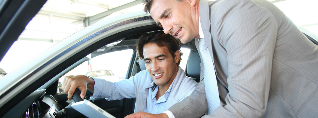 A stock photo of a sales person showing information to a client.