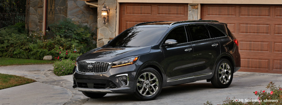 A left profile photo of the 2020 Kia Sorento parked in a driveway.