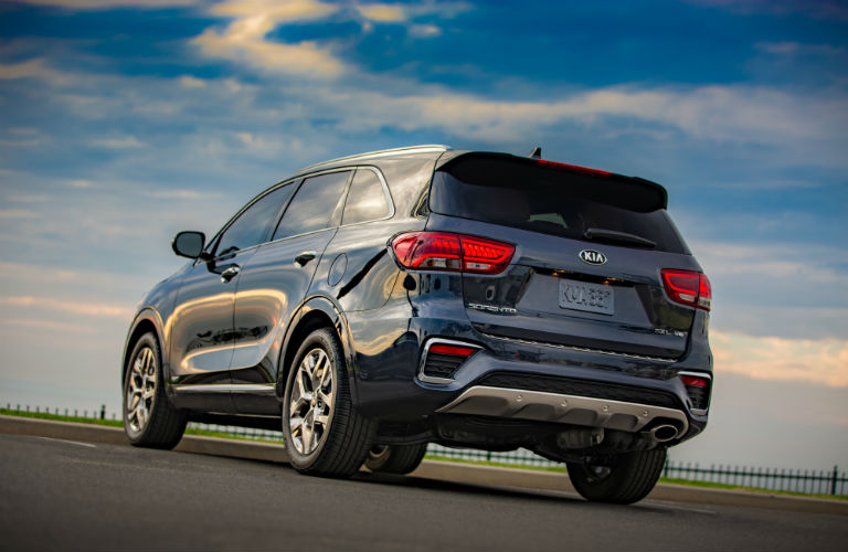 A rear photo of the 2020 Kia Sorento parked in a lot.