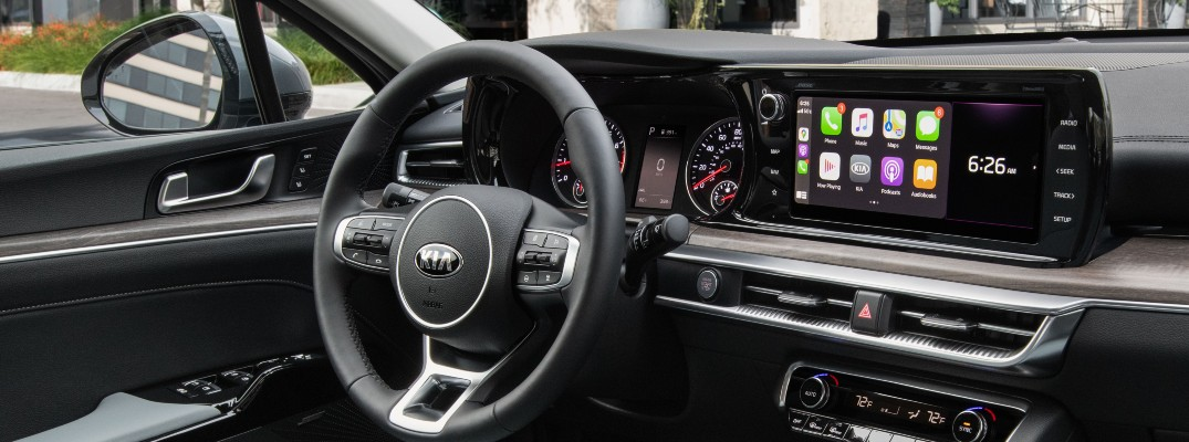 A photo of the driver's cockpit in a 2021 Kia vehicle.