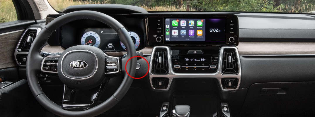 A photo of the dashboard in the 2021 Kia Sorento with the Engine Start/Stop button circled.