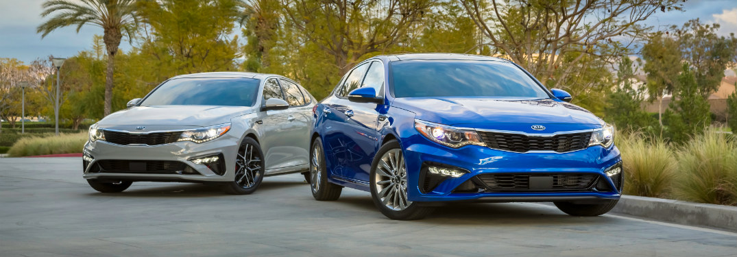 Blue and silver 2019 Kia Optima models next to each other