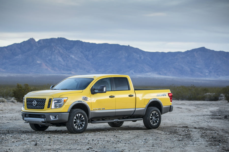 2016 and 2017 Nissan Titan shown in yellow against mountain background