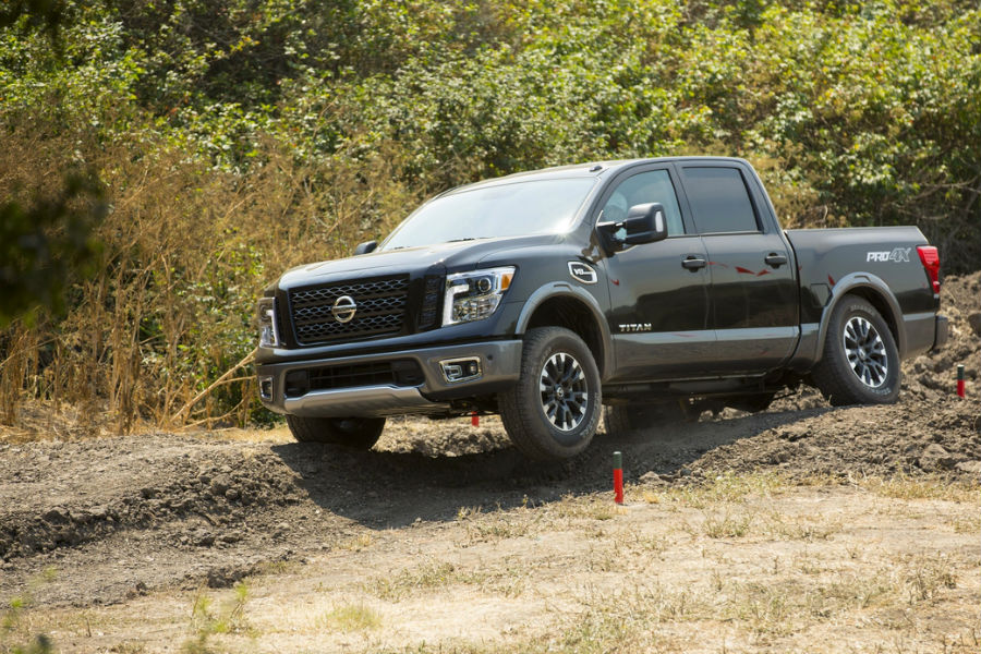 2017 Nissan Titan driving on dirt furrow off-road performance highlighted in pro4x model