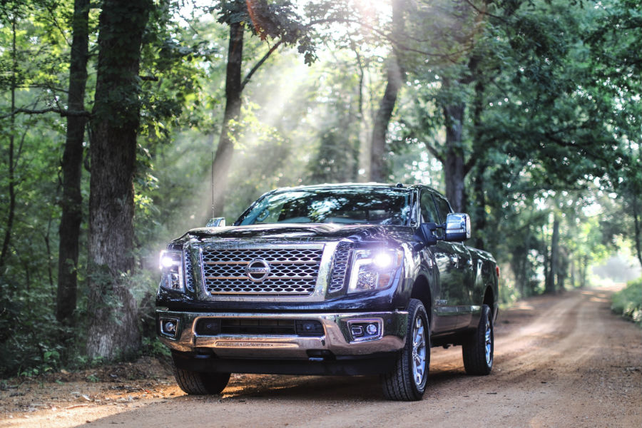 2018 Nissan Titan XD driving through woods