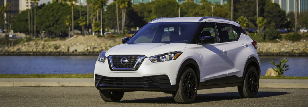 2018 nissan kicks white parked in front of lake near melbourne fl