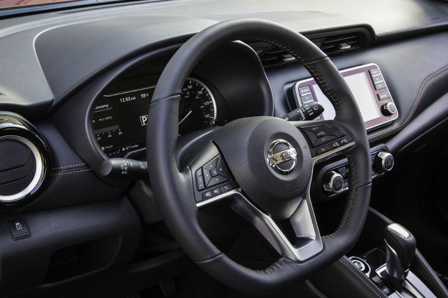 front seat interior from 2018 nissan kicks including infotainment steering wheel and dash