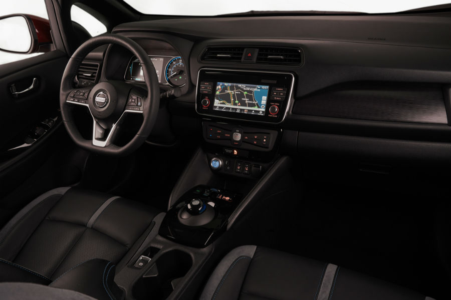 interior of 2018 nissan leaf with black leather and 7 inch infotainment screen