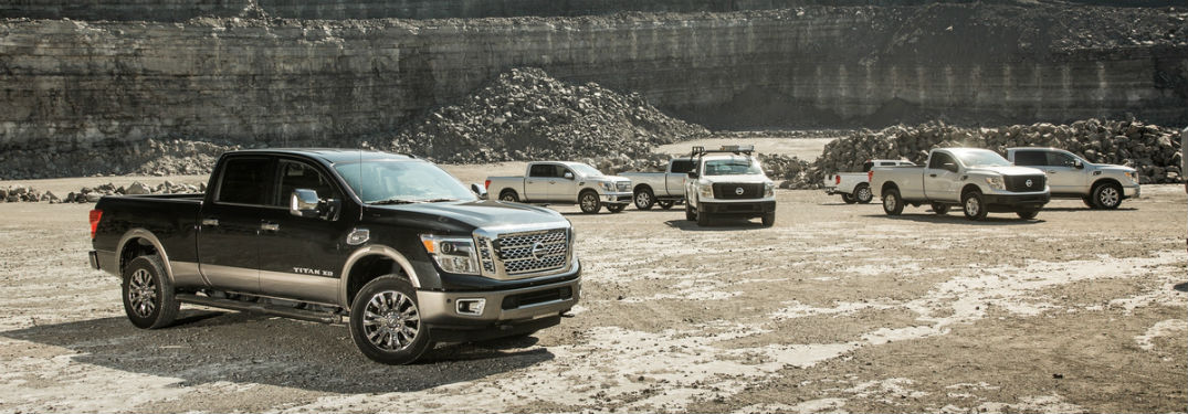 lineup of 2018 nissan titan and titan xd vehicles on stony job site