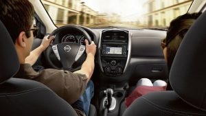 Interior view of man behind the wheel of the 2018 Nissan Versa Sedan