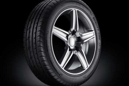 Tire over a black background