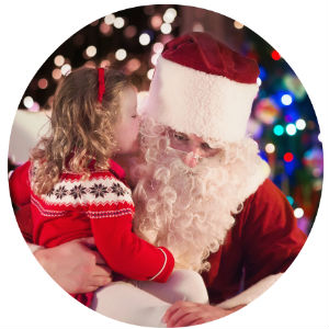 Young girl sitting on Santa's lap