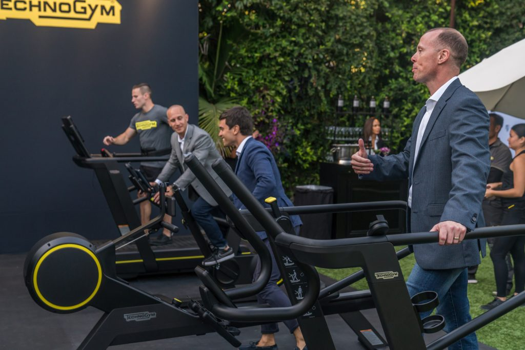 Attendees trying Technogym equipment