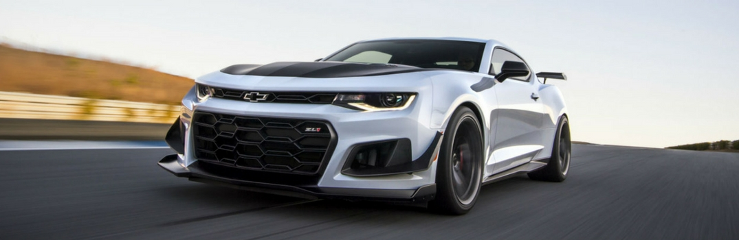 2018 Chevy Camaro driving on a road.