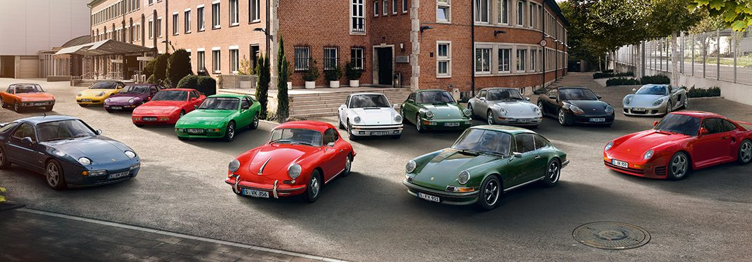 a variety of classic porsche models parked near each other