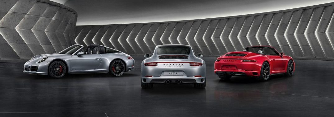 view of three 2018 Porsche 911 Carrara GTS Cabriolet parked near each other