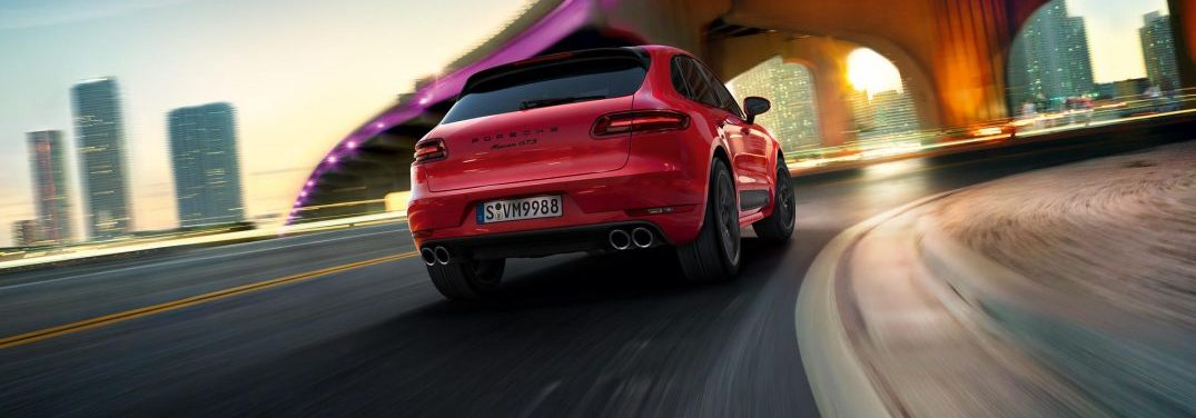 view of the back the porsche Macan GTS driving on a city highway