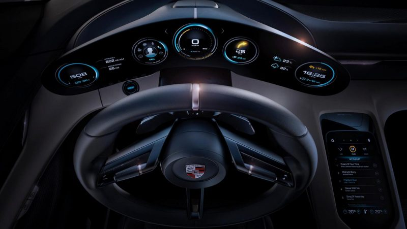 porsche taycan driver's seat view steering wheel and gauges