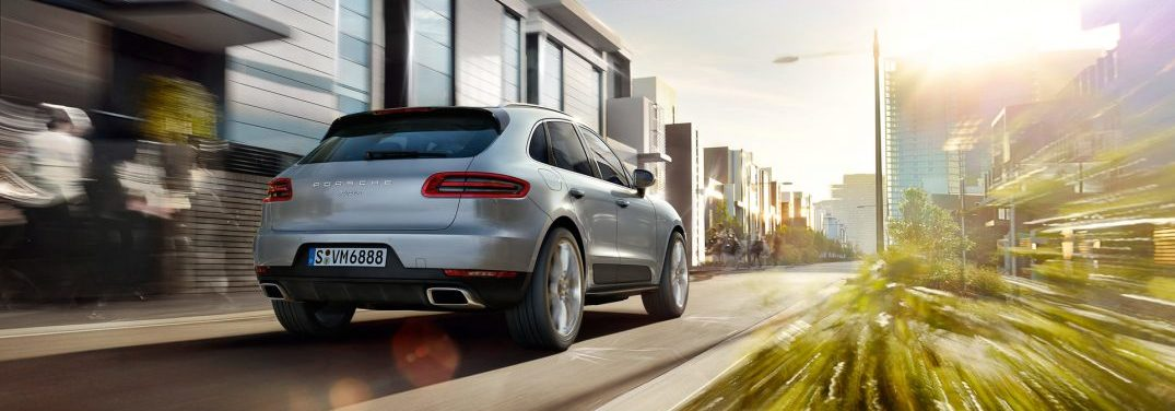 full view of the 2018 Porsche Macan driving in a city