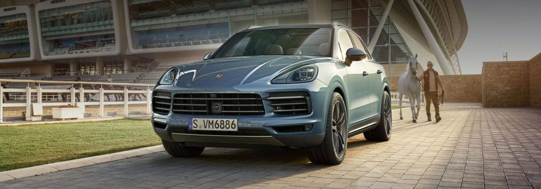 front view of silver blue Porsche Cayenne