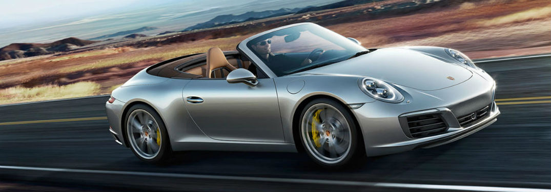 2019 Porsche 911 exterior front fascia and passenger side going fast on road