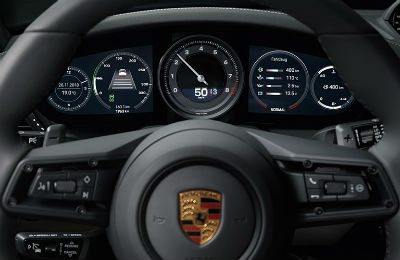 2020 Porsche 911 interior close up of partial steering wheel and digital instrument cluster