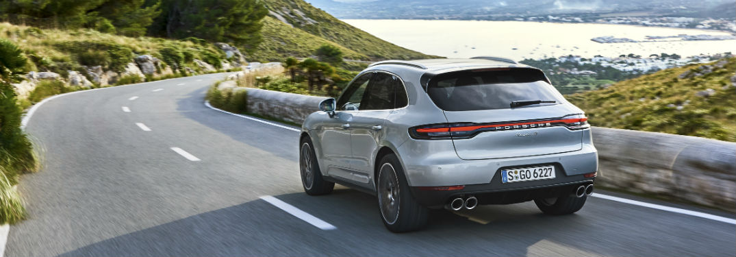 2019 Porsche Macan S exterior back fascia and drivers side on lakeside road