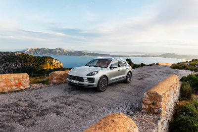 2019 Porsche Macan S exterior front fascia and drivers side next to water on bridge